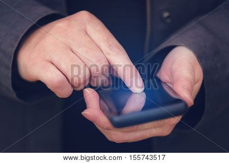 Close up of female hands using mobile phone outdoors finger pressing touch screen of smartphone electronics device