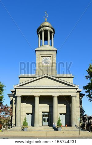 United First Parish Church was built in 1828 in downtown Quincy, Massachusetts, USA. Presidents John Adams and John Quincy Adams are buried in the family crypt beneath the church. Now this building is a US National Historic Landmark. poster