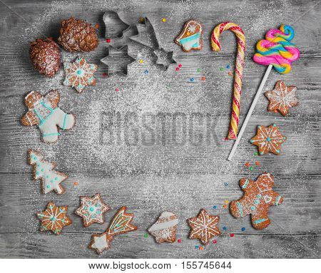 Christmas cookies cones. New year gingerbread. Christmas card with empty space in middle of text greeting. Forms for Christmas cookies candy cane. Cooking Christmas cookies. Top view blank space.