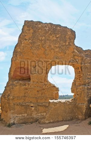 The ancient defensive wall with carved arches (Arcosolia) that serves as the tombs Agrigento Sicily Italy.