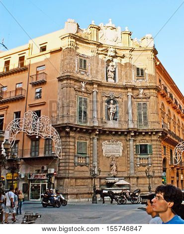 PALERMO ITALY - OCTOBER 2 2012: The Baroque architecture of Vigliena Square also famous as the Four Coners (Quatro Canti) named so because of four near-identical buildings located on each corner on October 2 in Palermo.