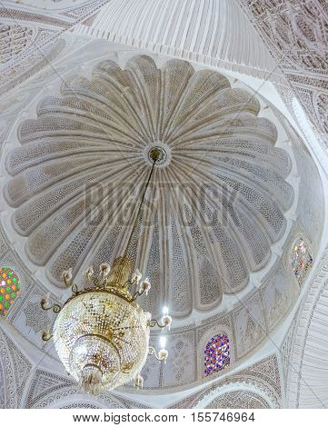 KAIROUAN TUNISIA - AUGUST 30 2015: The white dome of Zaouia Sidi Sahab (Barber's Mosque) decorated with fine fretwork on August 30 in Kairouan.