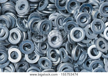 A bunch of silvery metal washers closeup