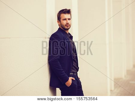 Fashion young businessman blue suit casual in city