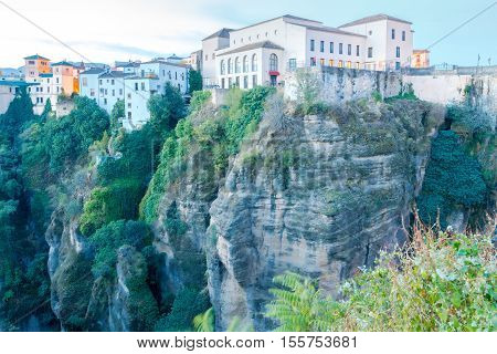 Buildings on a cliff above the gorge in Ronda. Spain. Andalusia.