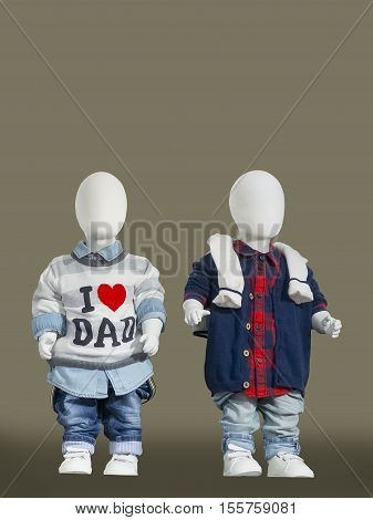 Two children mannequins dressed in a fall style isolated. No brand names or copyright objects.
