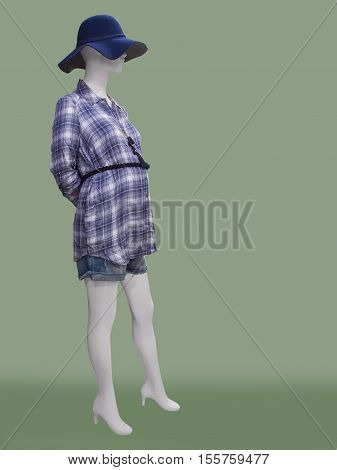 Female mannequin dressed in clothes for pregnant women against green background. No brand names or copyright objects.