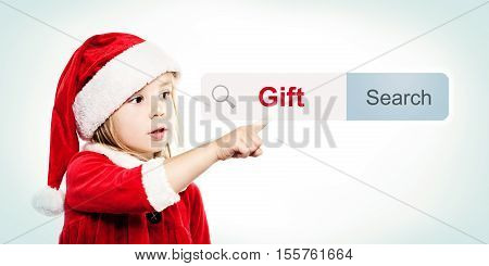 Child in Santa Hat look for a gift ing Gifts. Christmas Child