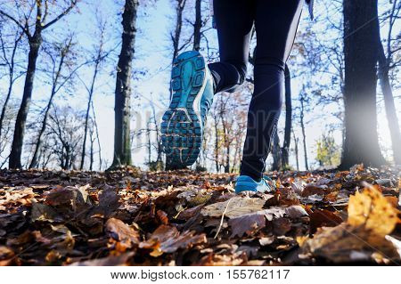 woman runner at sunset sunrise. Cardio fitness training sportswoman. Active healthy lifestyle in  nature outdoors.