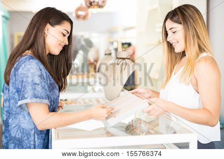 Woman Looking At Some Jewelry