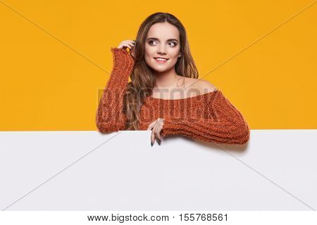 Autumn woman with publicity board.