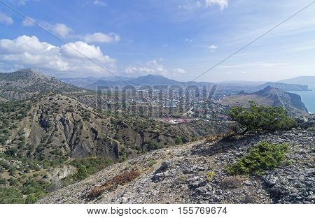 The view from the hillside on Sudak valley and the resort town of Sudak. Crimea September.
