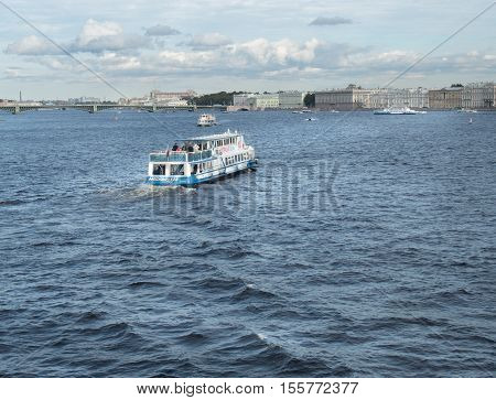 Saint Petersburg, Russia September 10, 2016: Excursion boat with tourists floats on the Neva river in St. Petersburg, Russia.
