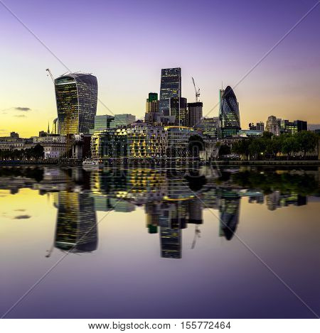 The Bank District Of Central London With Famous Skyscrapers At Sunset With Amazing Blue Sky And Refl