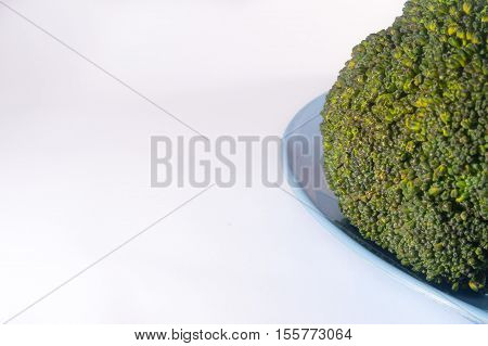 Green Brocolli On Blue Plate On White Background