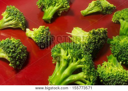 Green Brocolli On Red Plate On White Background