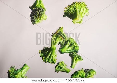 Freeze Dropping Green Brocolli On White Background