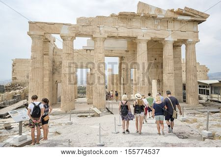 ATHENS, GREECE, SEPTEMBER 6,2016: Tourists are leaving the area of Acropolis from the remains of Propylaea at Athens, Greece.