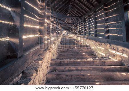 Shafts of light thru wooden slats in Sighisoara Romania