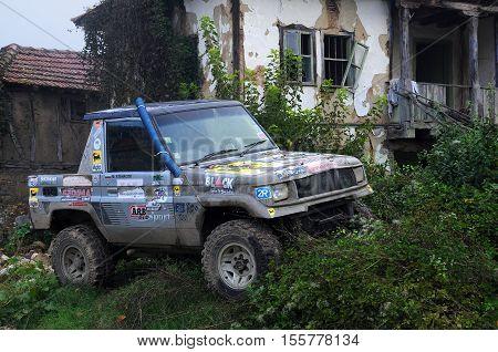 VETRINTSI VILLSAGE BULGARIA - OCTOBER 10 2014: Homemade truck parked near semi-destroyed house of the village