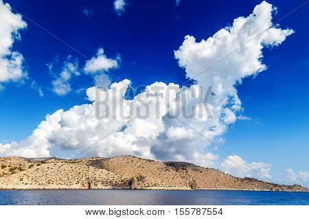 Blue sky and sea landscape with mountains clouds