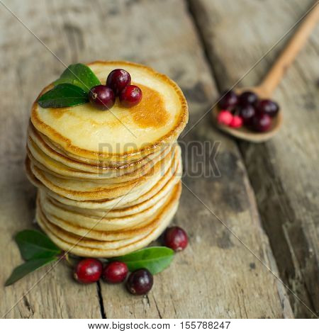 Stack of delicious pancakes with cranberry in a rustic style. Pancake's Day