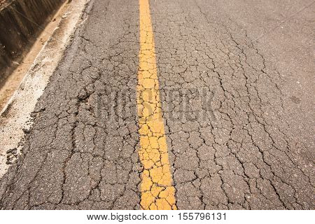 Old Road Yellow Line Surface Damgae and Cracking