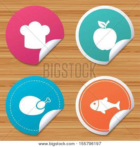 Round stickers or website banners. Food icons. Apple fruit with leaf symbol. Chicken hen bird meat sign. Fish and Chef hat icons. Circle badges with bended corner. Vector