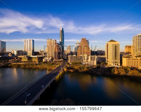 Golden Hour Sunset Austin Texas Skyline Cityscape Over Colorado River or Town Lake South Congress avenue bridge spanning across Lady bird lake