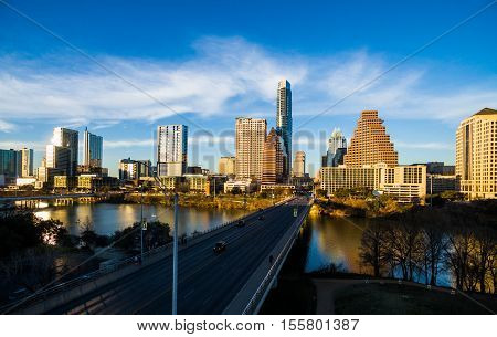 South Congress Avenue Bridge Over Austin Texas Skyline Cityscape along Colorado River with dramatic blue sky background on a nice summer evening