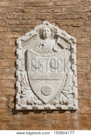 Old traditional heraldic relief of noble emblem with angel on a Venice wall