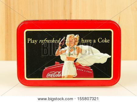 RIVER FALLS,WISCONSIN-NOVEMBER 09,2016: A vintage Coca Cola tin with a wood background.