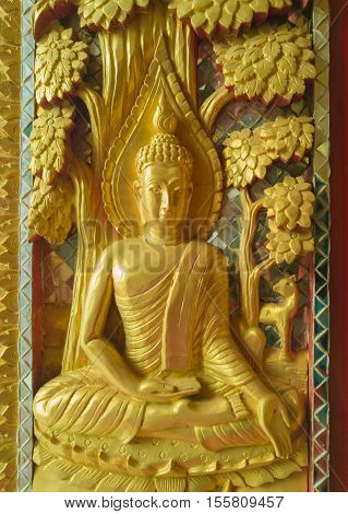 Golden Sculpture High-relief buddha on gate to sanctuary in temple Public domain
