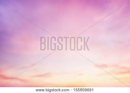 Blurred peaceful landscape sunset. Colorful pink blur glowing bokeh and blue sky. Soft focus open view nature. Abstract background Orange and purple gradient. Sunbeam summer rays light sandy