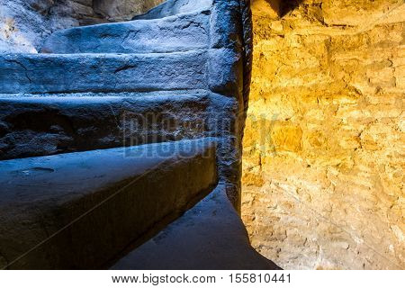 From Cold To Warm Light In Stone Staircase