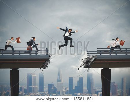 Business people overcome a broken bridge with a big jump