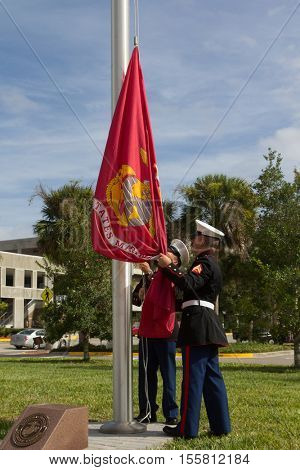 JACKSONVILLE, FL- NOVEMBER 8, 2016: US Marines raising the Marine Corps flag during a ceremony at the Veterans Day Tribute and a Veterans Plaza Dedication in Jacksonville.