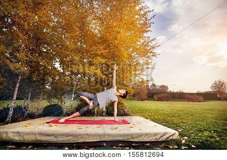 Yoga In The Autumn Park