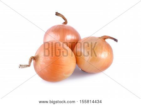 unpeeled fresh onion on a white background
