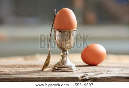 Eggs And Egg Cup In An Old Tray
