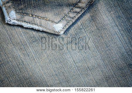 Denim jeans texture or denim jeans background with seam and pocket. Old grunge vintage denim jeans. Stitched texture denim jeans background of fashion jeans design.