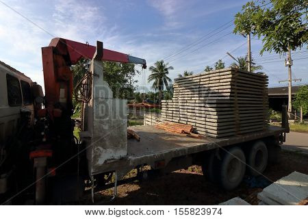 Silhouettes of stack of prestressed concrete slabs loaded on truck for construction