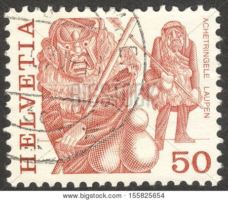 MOSCOW RUSSIA - CIRCA OCTOBER 2016: a stamp printed in SWITZERLAND shows traditional customs the series