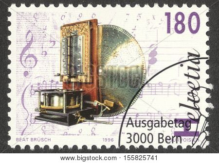 MOSCOW RUSSIA - CIRCA OCTOBER 2016: a post stamp printed in SWITZERLAND shows Phonograph of the type Kalliope the series