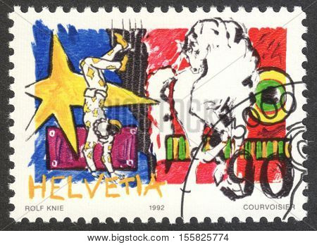 MOSCOW RUSSIA - CIRCA OCTOBER 2016: a stamp printed in SWITZERLAND shows Harlequin & Lipizzaner the series