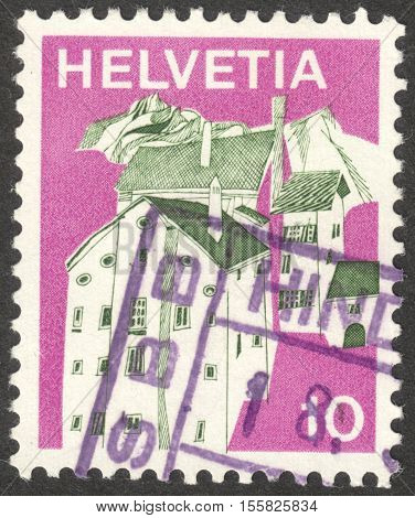 MOSCOW RUSSIA - CIRCA OCTOBER 2016: a stamp printed in SWITZERLAND shows a traditional landscape the series