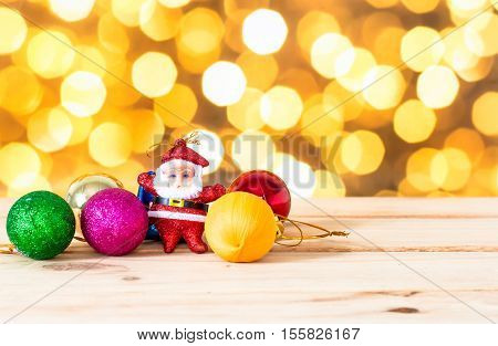 The Christmas Ball And Santa Doll On Wooden In Bokeh Light Background, Accessories Of Chirstmas Holi