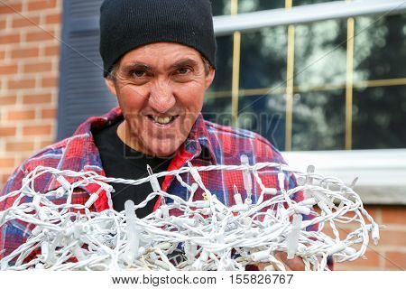about to tackle the dreaded job of untangling the Christmas lights and hanging them