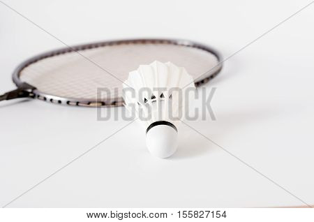 The White Badminton Shuttlecock And Racket On White Background