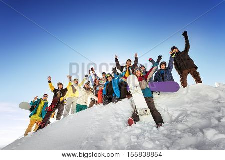 Group of friends skiers and snowboarders having fun. Skiing and snowboarding concept